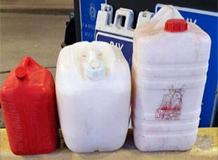 Three fuel containers containing 45 gallons of pulque